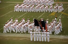 a color guard stands by as formations