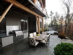 outdoor kitchen under balcony