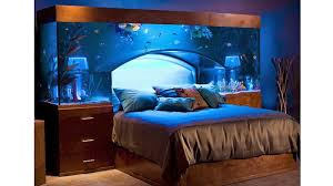 Forget about the race car or canopy bed you dreamed about as a child. This  custom-made aquarium headboard makes your boring old Serta setup just about  the ...