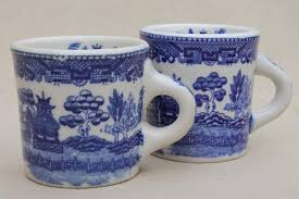Custom coffee mugs are a favorite promotional drink ware item , they sit on your desk or kitchen table with your logo and branding in full display. Blue Willow Pattern Coffee Mugs Vintage Japan Blue White China Ceramic Cups