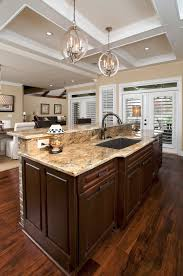 Wondrous Dark Brown Wooden Finished Large Counter Kitchen Island With Sink  And Marble Top Feat Ceiling Lights In Open Kitchen Designs Ideas