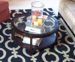i listed some things on craigslist last night including our red chair and ottoman and this round zgallerie coffee table sorry for the old fuzzy picture
