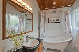 overhead shower head bathroom transitional with clawfoot tub freestanding bathtub granite counter greek