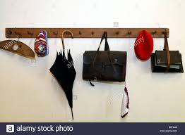 Coat Bag Rack Items from schoolchildren from an earlier era hanging on a coat rack 8