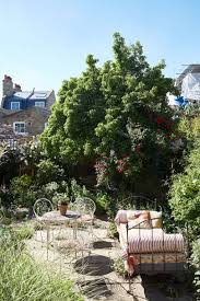 the founder of jamjar flowers knows how to create a beautiful garden even in a small space this garden at her brixton house has a romantic