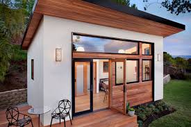All photos via Contemporist  Tiny living and prefab construction collide  beautifully in this backyard guesthouse ...