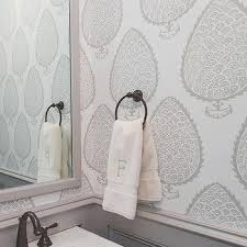 White And Gray Powder Room With Gray Wainscoting And Gray Leaf Wallpaper