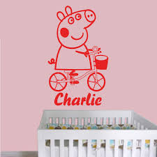 red peppa pig peppa cycling children s wall decal in a nursery  on peppa pig wall art stickers with peppa pig peppa cycling personalised with a name of your choice