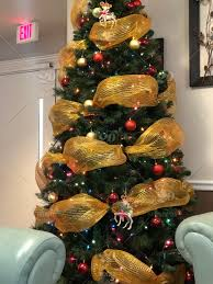 Office Christmas Tree With Gold Ribbon Trim Stock Photo