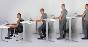 is it better to sit or stand at your desk