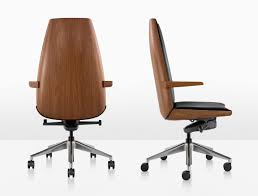 herman miller wood chair. the clamshell chair\u0027s shape follows a contour of compound curves found in nature, purity form difficult to express manufactured objects. herman miller wood chair