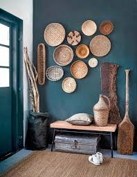 a teal entryway is made rustic and welcoming with baskets on the wall a crok