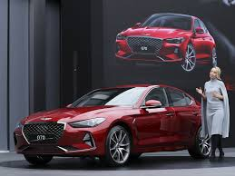 2018 hyundai genesis sedan. wonderful 2018 bozhena lalova a head of genesis color and trim hyundai motor co  speaks to the media next new sedan g70 during its unveiling ceremony in  intended 2018 hyundai genesis n