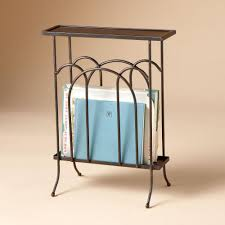 WROUGHT IRON MAGAZINE SIDE TABLE -- A slim iron table with a magazine rack,