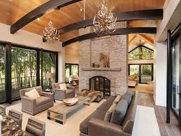 elegant antler chandeliers and grey leather sofa with stone fireplace for modern rustic living room ideas