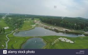 grass field aerial. Top View Green Golf Course Outdoor Grass Field. Aerial From Flying Drone Field O