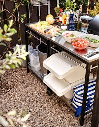An outdoor kitchen prepping area with workspace for making salads and side  dishes.