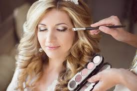 beautiful bride with wedding makeup and hairstyle stylist makes make up bride on