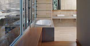 bathroom concrete countertop and tub surround by phil markham cheng concrete exchange