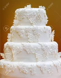 Delicious White Wedding Cake Decorated With Butterfly Stock Photo