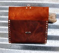 rustic leather clutch with hand strap and nickel rivets and nickel swivel clasp by bret cali