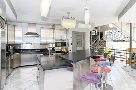 contemporary kitchen with raised breakfast bar counter
