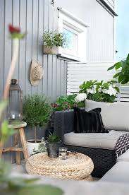 Black And White Patio Design Ideas Lush Greenery And A Silver Lantern Decorate This Small Black