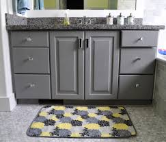 dark navy blue bath rugs: fabulous rectangular grey and yellow color bath mats with grey wooden double door and drawers