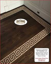 greek key inlay pattern of dark wood in light hardwood floor