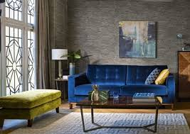 this interior looks very italian chic and i adore the geometric rug and velvet blue sofa the mustard yellow is a great accent colour