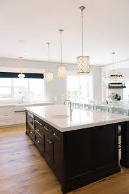 lighting above kitchen island. lighting small regina andrew metal patterned pendant fixture over kitchen island topped with white quartz countetop millhaven homes above