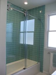 sage green glass subway tile shower walls