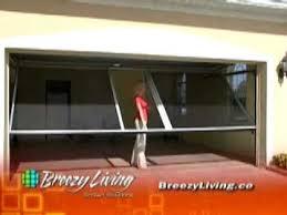 garage door screen system36 best LifeStyle Screens Garage Screens Doors images on Pinterest