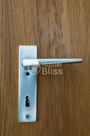 metal chrome european doorhandle wood texture background hunter bliss photography