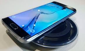 samsung galaxy s6 edge plus. galaxy s6 edge on top of samsung wireless charger plus