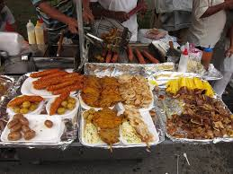 photo essay n street food chicken meat potatoes and salad make up the typical plate of street food in