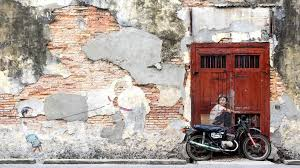 boy on a bike and little boy with pet dinosaur street art mural in george town penang malaysia photo by rmnunes on famous wall art in penang with famous street art mural in george town penang malaysia stock