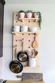 free up cabinet space with a diy wall mounted pot rack