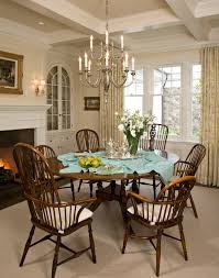 los angeles barbara barry chandelier dining room beach style with light gray rug bronze chandeliers round table