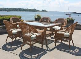 rattan dining room set. inviting lakehouse deck with traditional rattan dining set facing the lake room
