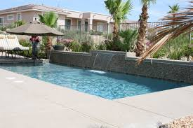 Fabulous Stacked Stones Waterfall Pool Ideas With Umbrella Patio Deck As  Well As Cool Rectangular Pool As Modern Landscaping Designs