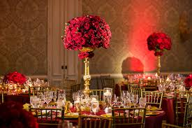 bold red wedding with flowers by cina and luxe linen featured on inside weddings