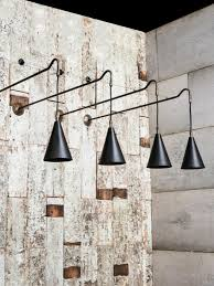 brass wall light with hanging braided cable drop and filament lamps perfect for an over bar feature