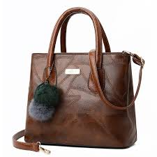 hot deal us 37 98 for fashion women s leather handbag with hairball casual soft leather shoulder bags desgner las hand bags famous brand women bags