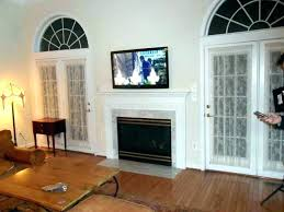 hanging tv over fireplace install above brick hide wires