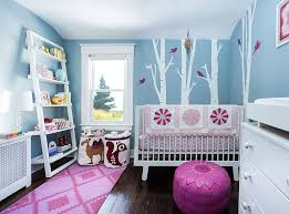 gorgeous blue nursery with a woodsy theme and a touch of pink photography stefan