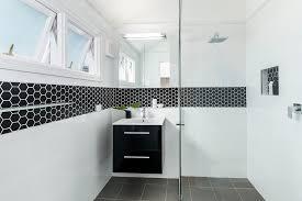 bathroom accent tile ideas bathroom contemporary with chrome fixtures shower shelf black hexagonal tile