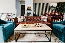 All decor does not have to match. Add personality to your living room with  contrasting colors and patterns.