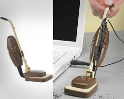 the mini desk vacuum is a small desk vacuum that is actually shaped like a stand up carpet vacuum why swipe the crumbs on your desk with your hand into the