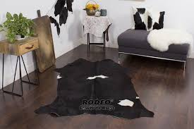 elegant dark black spots cowhide rug 6 4 x 7 1642 rodeo inside designs